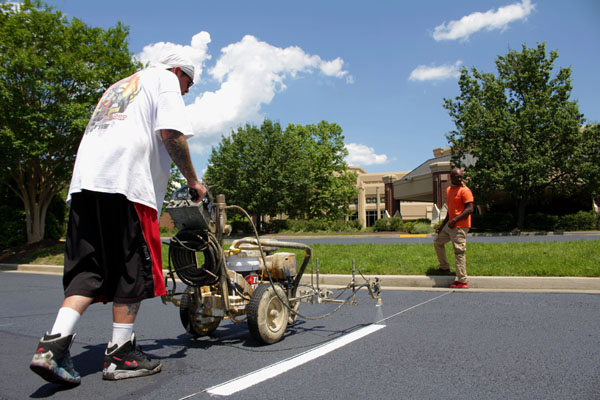 Parking lot marking & painting services in the greater Richmond, VA area - VDOT approved paint - ADA signs available.